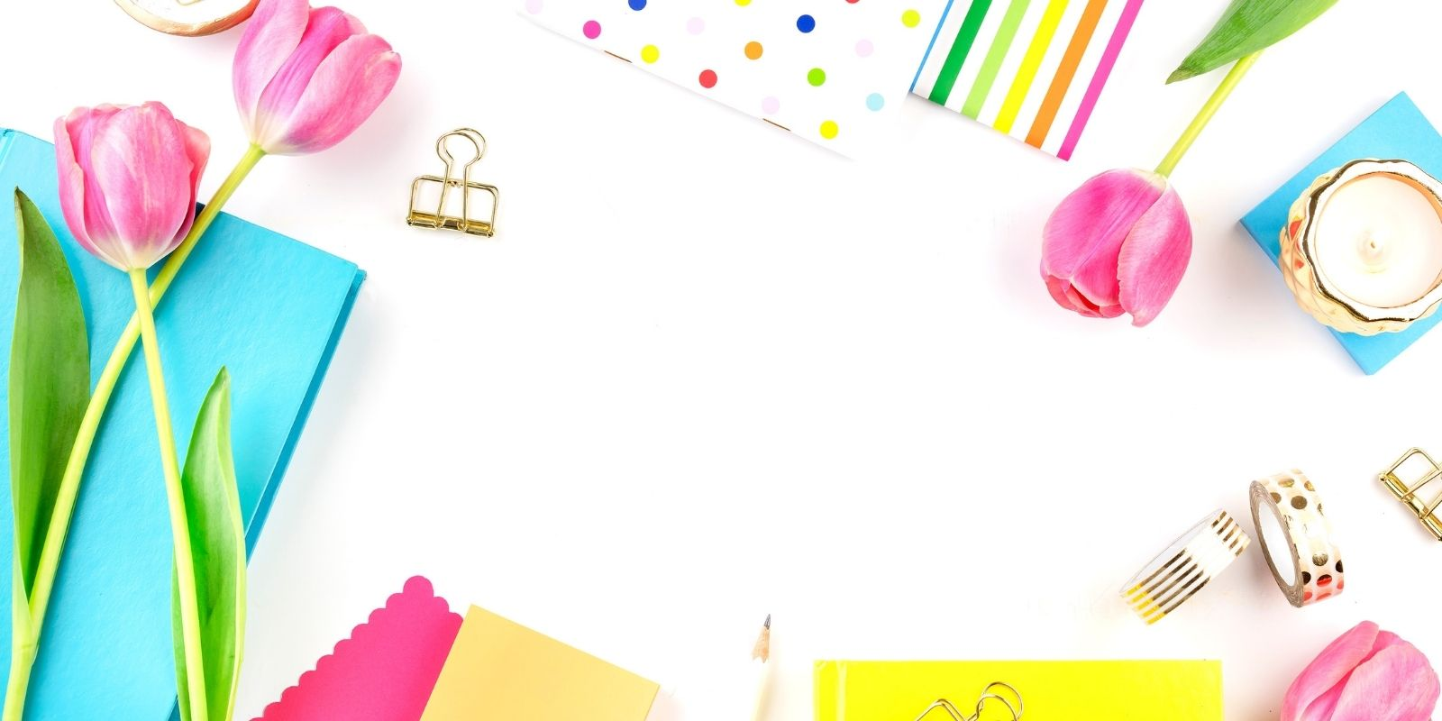 Colorful desktop accessories on white background