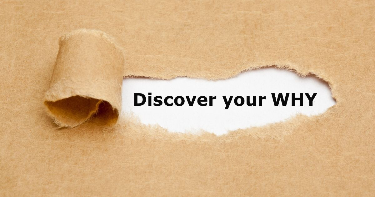"""Torn kraft paper revealing the words: """"Discover your why"""""""