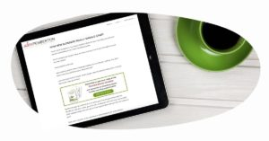 Blog post on an iPad, with coffee in a bright green coffee cup next to it