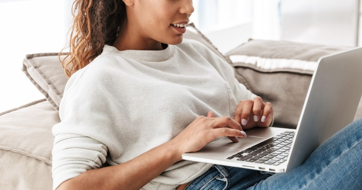 Woman typing on a laptop